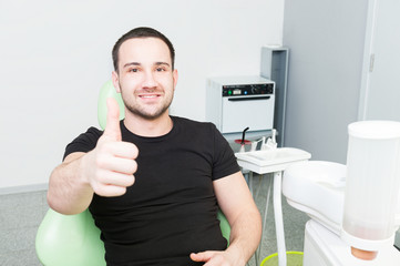 Happy dentist patient showing like