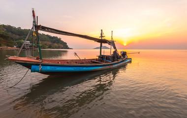 A small boat in sunset time at Ao Yang Beach,Chanthaburi,Thailan