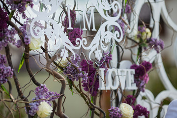 Beautiful whitel floral sign decoration at wedding aisle