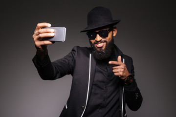 Man in trendy cloth taking selfie photo