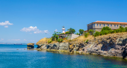 small island of saint anastasia is a new tourist attraction in bulgaria near burgas. reconstructed museum, hotel, restaurant and lighthouse are accompanied by small cute beach.