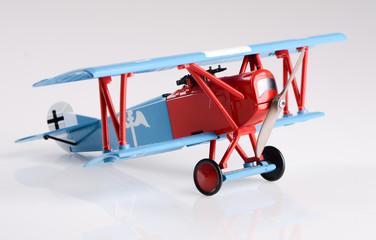 Model toy plastic plane isolated on white background.