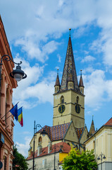 The 73.34 m high steeple with clock and four turrets of the Evangelic Church, the landmark of the city, built in 1530 in the Huet Square in Sibiu, Romania.