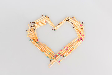 Matches in the shape of a heart on a white background, a declaration of love on Valentine's Day, the original concept