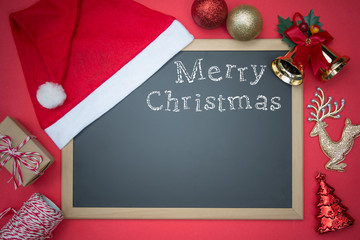 Blackboard With Red Santa Hat And Christmas Decoration. English Text Merry Christmas