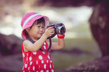 Asian girl photographer with professional digital camera