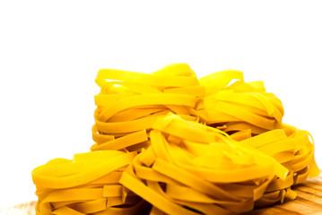 Italian noodle nest on white background