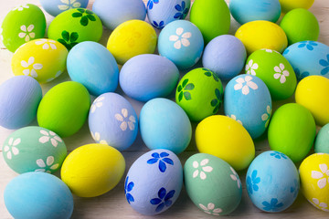 Hand-painted pastel colored Easter eggs background