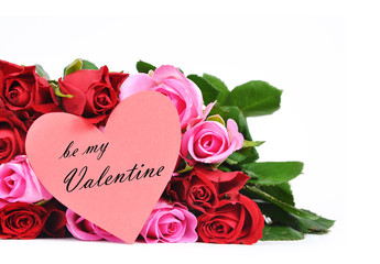 Red and pink roses with heart shaped Valentine's card