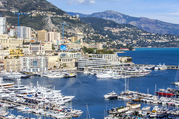 MONTE-CARLO, MONACO, on JANUARY 10, 2016. A view of houses on a slope of the mountain and the yacht at the mooring in a bay