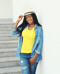 Fashion beautiful smiling african woman wearing a straw hat and