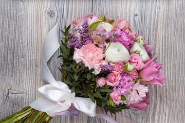 Valentine flowers on wooden background