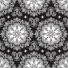 Seamless pattern mehndi background with flowers and lace buta decoration items on black background.