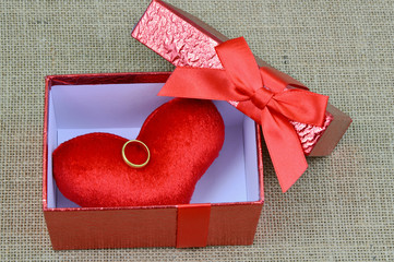 red heart and gold ring in the red box for love
