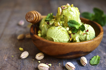Pistachio ice cream with chopped nuts and honey.