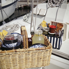 Aluminium Prints Picnic Food items with tableware in picnic basket on sailboat