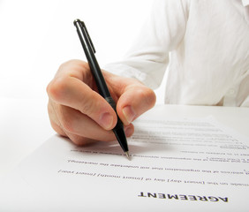 Businessman's hand signing papers. Lawyer, realtor, businessman
