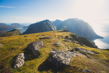 Classic norwegian scandinavian summer mountain landscape view with mountains, fjord, lake with a blue sky, Norway, Lofoten Islands