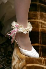 bride shows her wedding garter