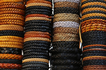 Braided leather belts stacked