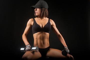 True professional. Portrait of a beautiful young woman lifting dumbbells