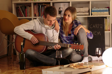 Man plays romantic songs to his girlfriend
