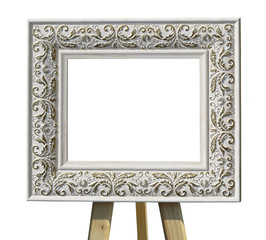 Old vintage ornate white picture frame on a stand with pattern i