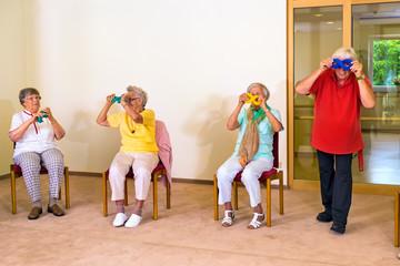Four seniors having fun during exercise class.