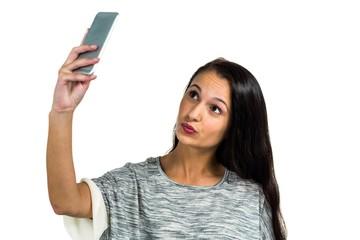 Facing woman taking selfie