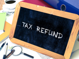 Tax Refund Concept Hand Drawn on Chalkboard on Working Table Background. Blurred Background. Toned Image. 3D Render.