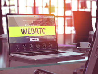 WEBRTC - Web Real Time Communication - Concept. Closeup Landing Page on Laptop Screen  on background of Comfortable Working Place in Modern Office. Blurred, Toned Image. 3D Render.