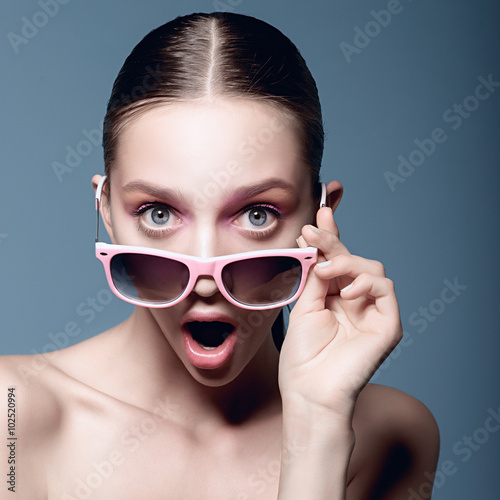 """Stunning And Surprising New Looks: """"Portrait Of Beautiful Young Girl In Sunglasses On A Blue"""