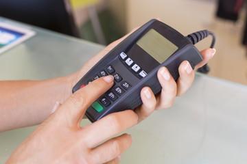 Closeup hands woman swipe through terminal, security code