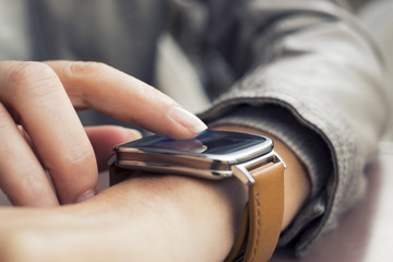Closeup of woman's hands  using a smartwatch
