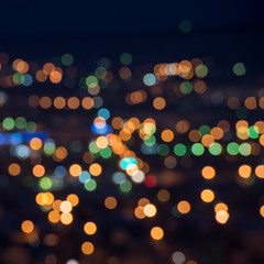 beautiful city lights background with blurring bokeh in twilight