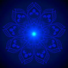 Hand drawn shine blue flower mandala over dark blue