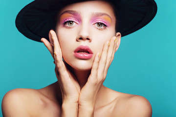 Beauty Girl Portrait with Colorful Makeup, Nail polish. Colourful Studio Shot of Funny Woman. Vivid Colors. Rainbow Colors