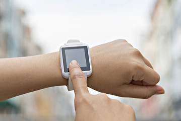 Female hand touching smartwatch