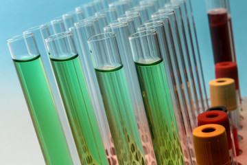 Row of test tubes in green tone
