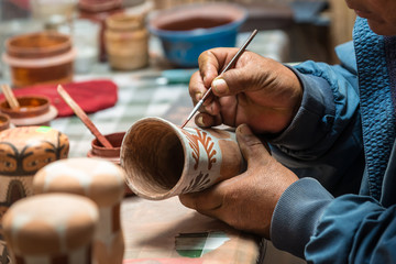 Peruvian Artisan painting a typical peruvian vase