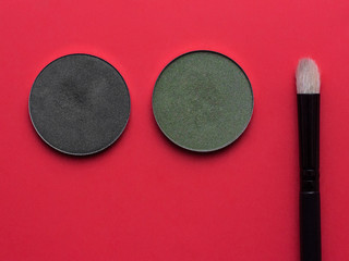 For Make-up. Bright shade with  brush on a red background
