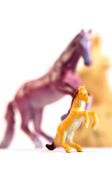 Toy horses / Plastic toy horses on the table.