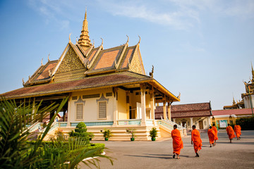 Monks walking in front of Royal Palace in Phnom Penh Cambodia
