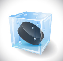 Ice cube with hockey puck .