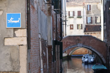 Italy, venice. Signs in venice, sign on passing gondolas