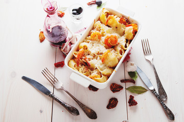 Baked Conchiglioni pasta with srimps, cheese and cream sauce, traditional Italian cuisine