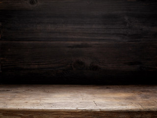 wooden table and dark wooden wall Wall mural