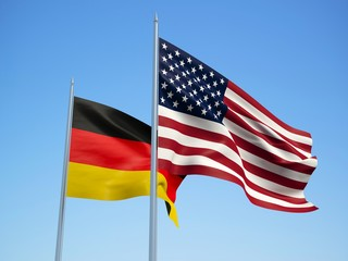 Germany and American flags waving in the wind with a blue sky background. 3d illustration
