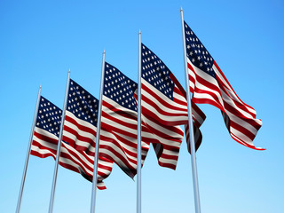 American flags waving in the wind with a blue sky background. 3d illustration