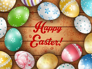 Easter greeting card with color eggs on a wooden background